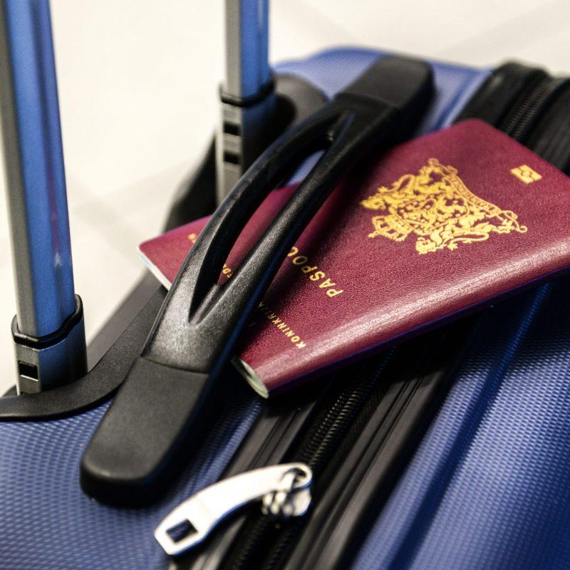 Canva - Passport on a Suitcase-min